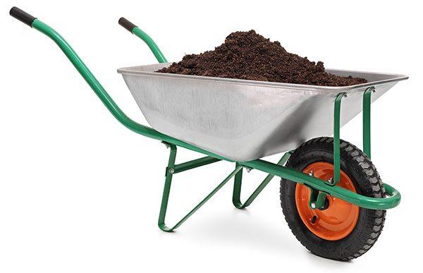 metal wheelbarrow filled with soil